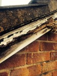 Damaged dry verge showing rotten wood before replacement by Jones uPVC